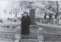 Blanche (Hinman) Garland in front of Miller plot in Greenwood Cemetery - 1950